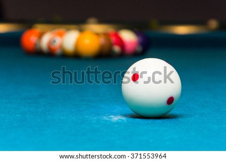Closeup of the white ball on a pool table / White billiard ball - stock photo