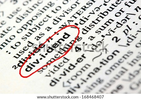 Closeup of the word dividend in the English dictionary