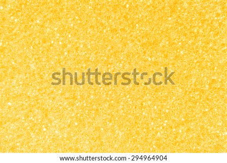 closeup of the yellow golden  porous texture background - stock photo