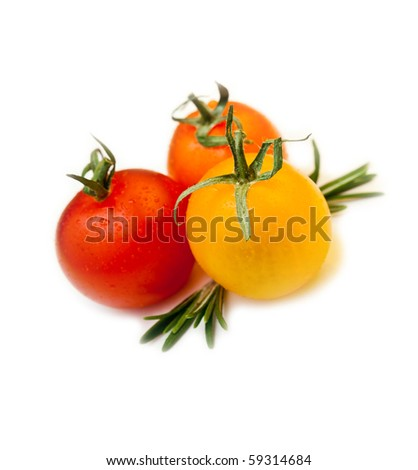 closeup of three cherry tomatoes with rosemary on white - stock photo