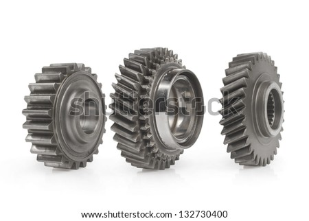 Closeup of three metal cog gears - stock photo