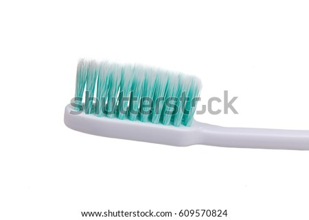 Closeup of toothbrush with soft and slim tapered bristle recommended by dentist