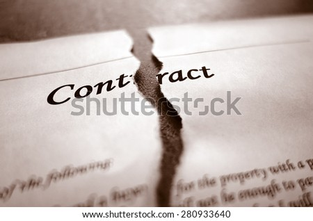 Closeup of torn legal contract                              - stock photo