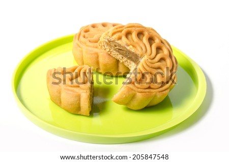 Closeup of traditional Chinese mooncake and cutout over white background - stock photo