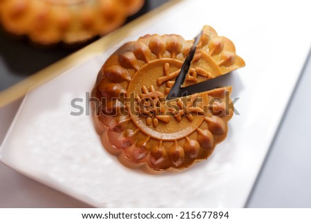 Closeup of traditional Chinese mooncake and cutout. Shallow dof, selective focus.  (The chinese words indicates the type of mooncake, not the brand) - stock photo