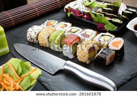 closeup of tray with sushi assorted on the table restaurant / japanese sushi - stock photo