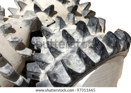 Closeup of tricone rock drilling bit isolated on white - stock photo