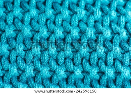 closeup of turquoise knitted wool texture, background - stock photo