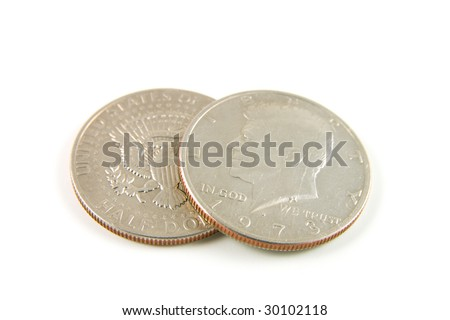 closeup of two american 1973 half dollars showing bot the head and tail sides on a white background - stock photo