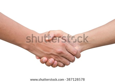 Closeup of two businessmen, lawyers or politicians shaking hands to celebrate a successful agreement.