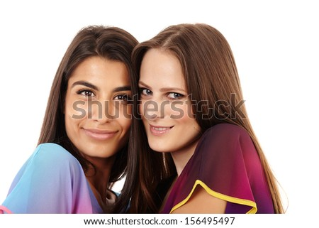 Closeup of two girlfriends isolated on white