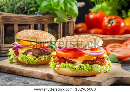 Closeup of two homemade burgers made �¢??�¢??from fresh vegetables - stock photo