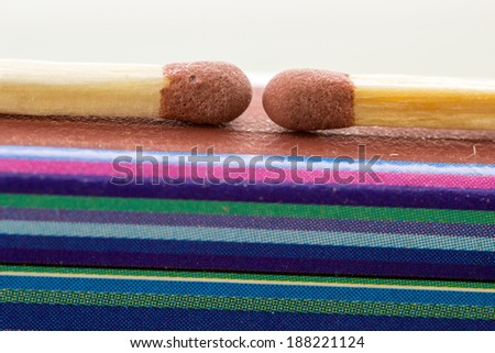 Closeup of two matches with a box, colors and lines - stock photo