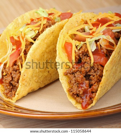 Closeup of two tacos on a plate - stock photo