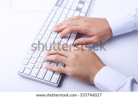 Closeup of typing businessman hands on computer keyboard.