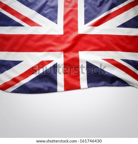 Closeup of Union Jack flag on plain background. Copy space  - stock photo