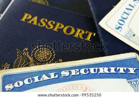Closeup of US Social Security cards and passports - stock photo