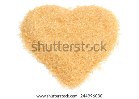 Closeup of valentine heart of sweet brown sugar. Isolated on white background - stock photo