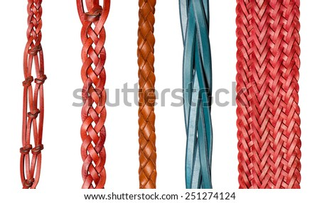 Closeup of various brown leather belts isolated on white background - stock photo