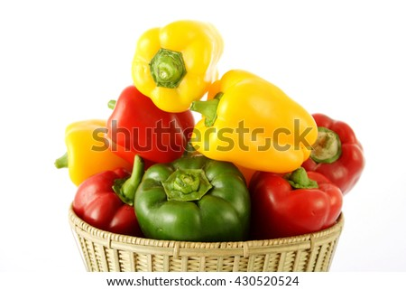 Closeup of various capsicums in a basket - stock photo