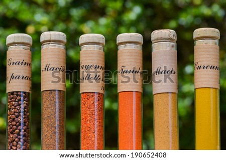 Closeup of various colorful spices, powders and herbs