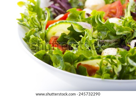 Closeup of vegetable salad on white background - stock photo