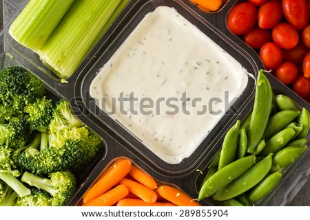Closeup of vegetable tray with assorted cut vegetables and dip. - stock photo