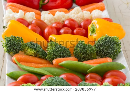 Closeup of vegetable tray with assorted cut vegetables and dip.
