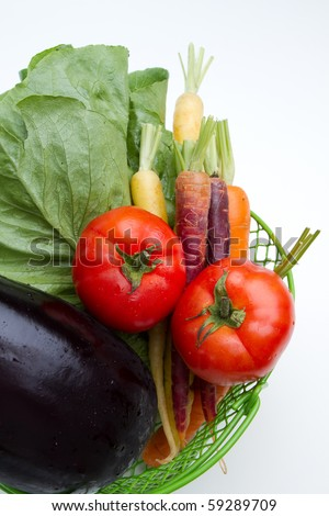 Closeup of vegetables in a basket. - stock photo