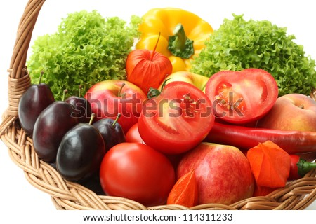 Closeup of vegetables in wicker basket, isolated background