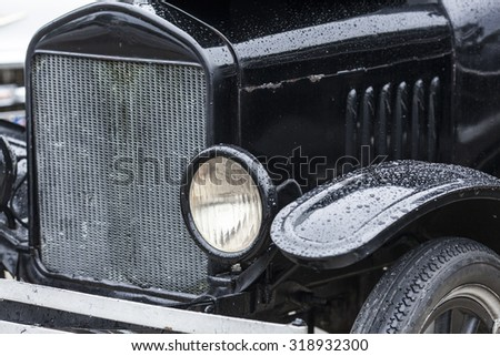 closeup of vintage car headlamp and radiator, car background - stock photo
