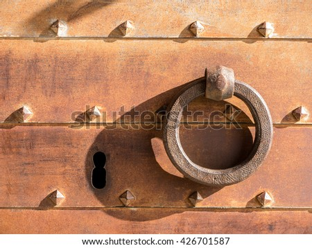 Closeup of vintage lock and iron door