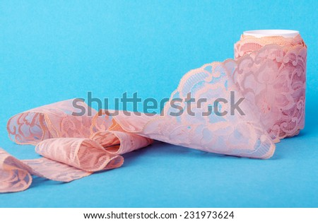 closeup of vintage pink lace patterned with flowers - stock photo