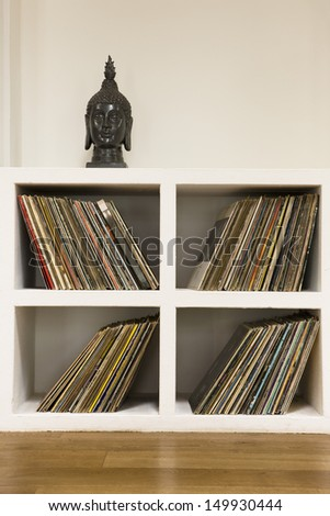 Closeup of vinyl records in shelf at home - stock photo