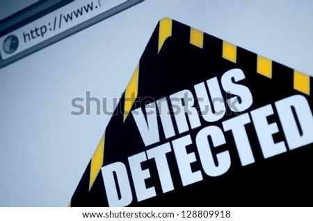 Closeup of Virus Detected Sign in Web Browser on LCD Screen - stock photo