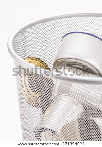 Closeup of waste basket with recycled aluminum cans. - stock photo