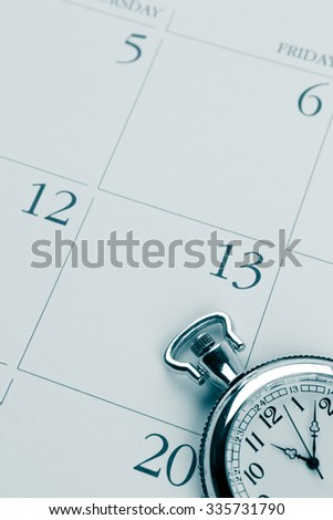 Closeup of watch on calendar
