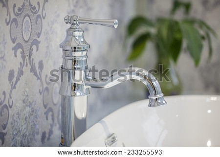 Closeup of water-supply faucet isolated in modern bathroom