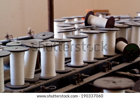 Closeup of weaving thread for the textile industry  - stock photo