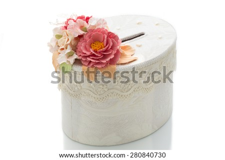 Closeup of wedding gift box decorated with flowers. Isolated over white background.