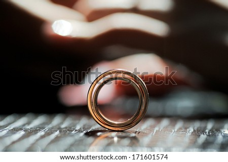 closeup of wedding rings in sunlight - stock photo