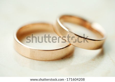 closeup of wedding rings on table - stock photo
