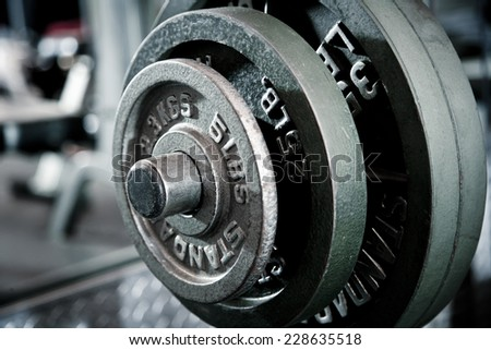 Closeup of weights- incline bench press. - stock photo