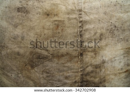 Closeup of wet stained tarpaulin as a grunge  background - stock photo