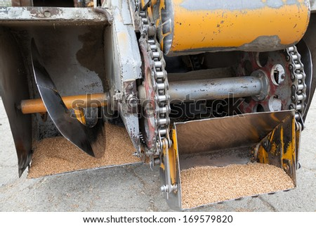 Closeup of wheat harvesting machine