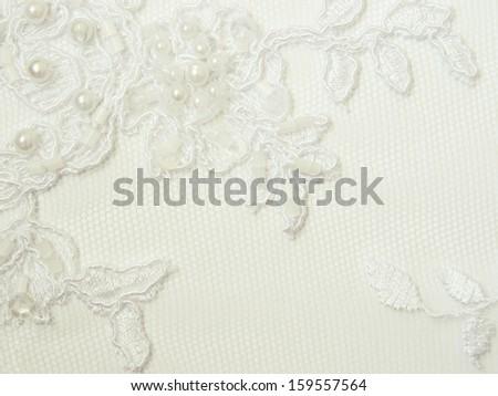 lace up logo  Closeup of white wedding lace
