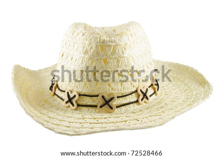 Closeup of white yellow large hat over white surface - stock photo
