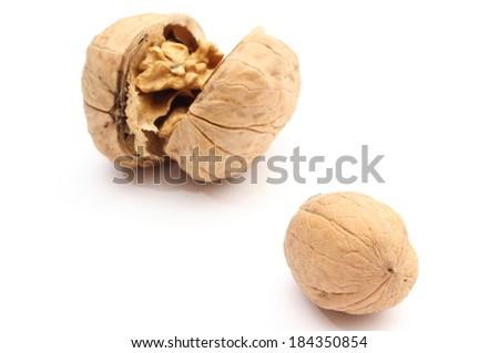 Closeup of whole brown fresh walnut and opened big walnut. Isolated on white background - stock photo
