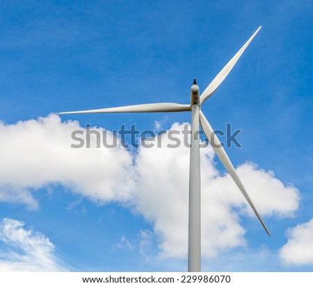 Closeup of wind turbine producing alternative energy in wind farm Thailand, concept of renewable and clean energy.