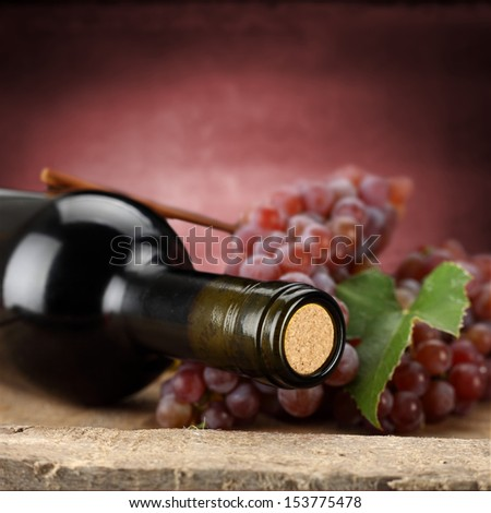 closeup of wine and red wall  - stock photo